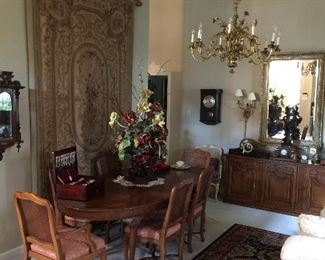 Beautiful formal dining table, leaves, 6 chairs, sideboard and huge needlepoint.