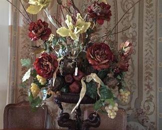 Stunning floral arrangement in heavy iron planter.