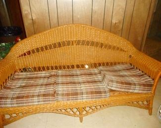Vintage Wicker with Cushion Love Seat..in basement