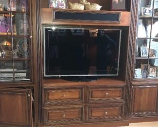 Unbelievable custom-made entertainment center and television for sale. Comes in 3 pieces