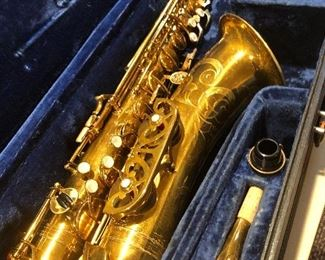 Super Dynaction saxophone with original case and mouthpiece and other pieces