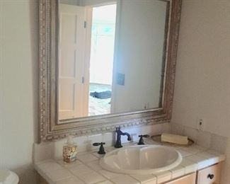 There are several bathroom vanities and mirrors.