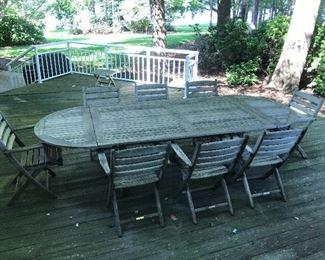 Teak outdoor table & 8 chairs by Kingsley- Bate