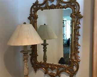There are a pair of these ornate mirrors