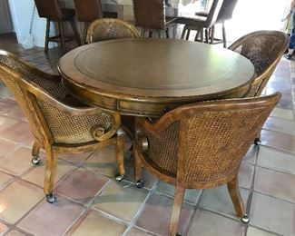 Game table with four cane seat chairs