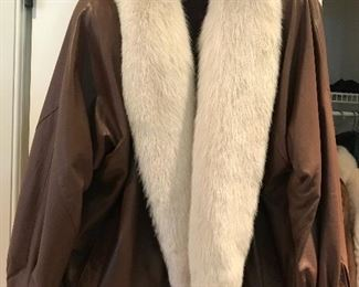 Brown leather jacket with white fox fur trim
