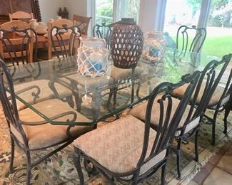 Glass top table with iron base & 8 chairs by Carson