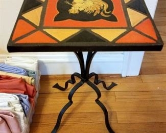 Wrought iron base table with tile top. $40