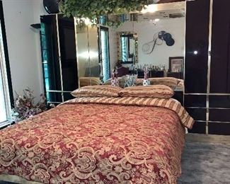 Black Glass and brass Ello Queen Bedroom set/mattress; back mirrored Pier and side cabinets.  Cost new for set: $8,000.00.  selling for $1,500.00 WILL NOT BE 70% OFF