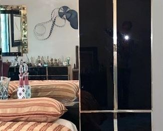 Black Glass and brass Ello Queen Bedroom set-back mirrored Pier and side cabinets.  Cost new for set: $8,000.00.  WILL NOT BE 70% OFF