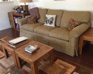Gold tone sofa