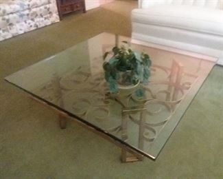 Heavy glass and iron coffee table.