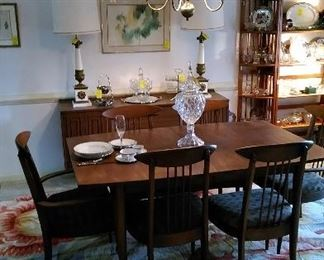 Mid century modern dining table with six chairs, floral area carpet