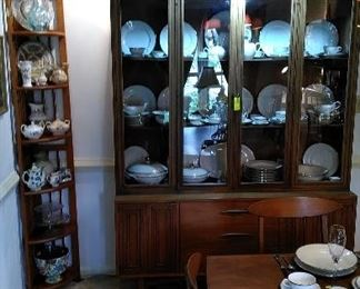 Mid Century Modern china hutch with fine porcelain china.