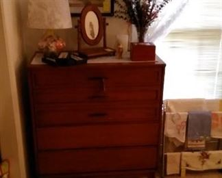 Mid Century Modern chest of drawers with accessories.