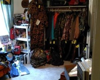 The Camo Room!  Many coats, shirts, pants, overalls, gloves, boots, hats, back packs, etc. to chose from. Nascar items, Swimming fins, snow skies and boots and plenty of back to school 3 ring binders.