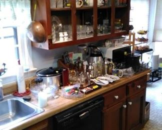 More kitchen and bar items, Tupperware, crock pot, etc.