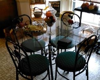 Great glass top sun room table with four chairs