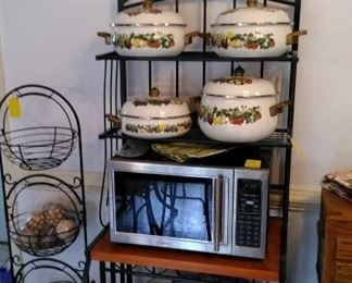 Baker's rack with cookware, microwave and 3 basket stand.
