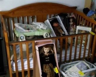 Baby crib, dolls and accessories.
