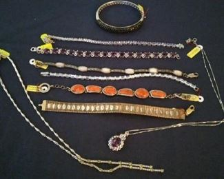 Sterling and precious stone bracelets and necklaces (not kept on the premises until the day of the sale).