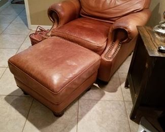 Leather chair and ottoman matches living room sofa also offered for sale