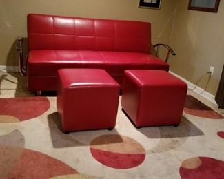 Ashley Furniture, leather flip flop convertible sofa opens out to bed, Also red matching ottomans