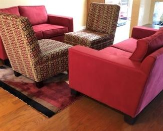 Contemporary Red Sofas, Patterned Armless Chairs and Area Rug