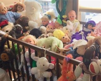 Cribs with lots and lots of Stuffed Animals and Dolls