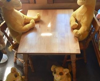 Lion King Stuffed Animals sitting at a Children's Table