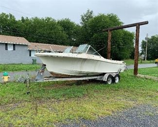 Boat & trailer $1500