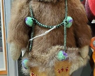 Spectacular very vintage Inuit doll in sealskin with leather and beaded gloves.Needs a little foot TLC.