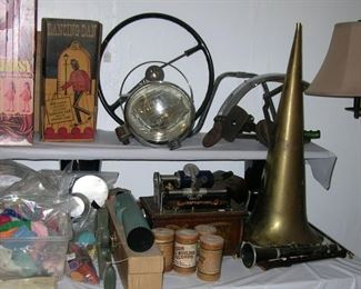 Old car parts! A Graphophone and some Edison cylinders, some old Schwinn bike parts, a clarinet