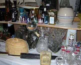 Cased glass decanter set, Yelloware biscuit jar with lid, a carriage clock, some Waterford, an old English baking dish