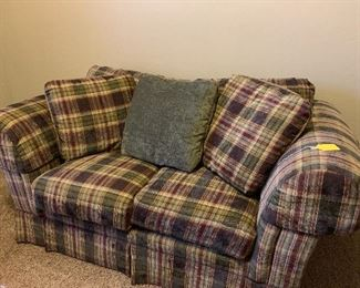 This couch has no tears or stains.  It looks like and feels like it has NEVER been sat in!