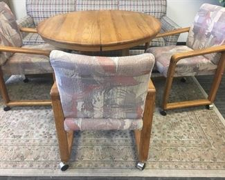 42 Round Table with Three Upholstered Rolling Chairs