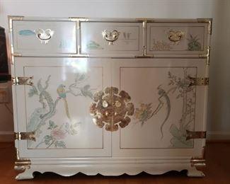 Cream colored lacquer cabinet