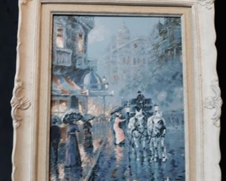 Framed canvas painting of a rainy evening in a European city. Unknown artist.