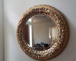 Ornate gold toned circular mirror