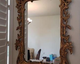 Ornate rectangular gold tone mirror