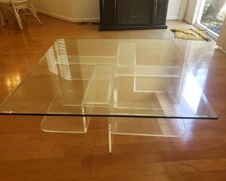 Square glass coffee table with plexiglass base