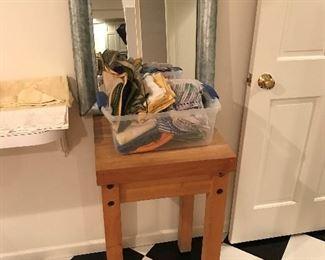 Butcher block table; cool metal-framed mirror.