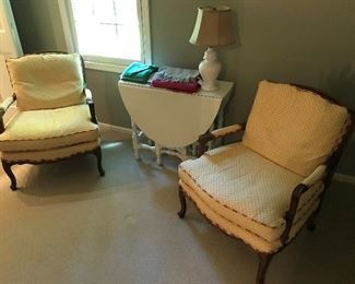 Pair of Baker Furniture French bergere chairs; nice gate leg table, painted white.