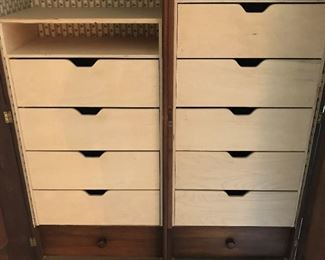 Close-up look at drawers in armoire.