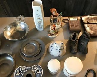 Great diversity of fun and unusual items, including a couple of vintage Hummels, baby booties, pottery, etc.