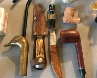 Antique knives and vintage pipes.