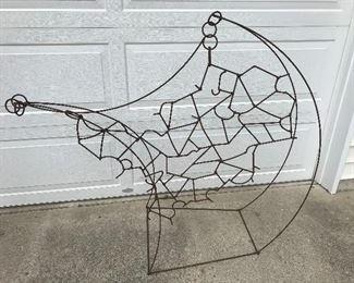 Unusual and fun metal sculpture/yard art.