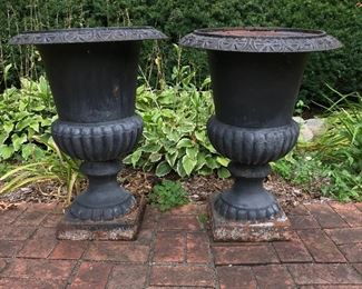 Two large metal planters.