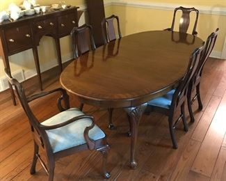 Exceptional dining table with leaves and six chairs.