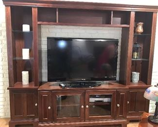 "Lighted TV wall unit-entertainment center w/glass shelves - 7'8"" X 6'3"" - TV in cabinet is 52"" with room to spare"